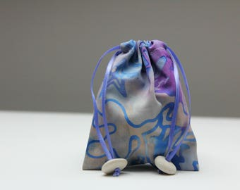 Pebble Pouches (Purple aquarium print). Drawstring cotton bags with natural stone toggles.