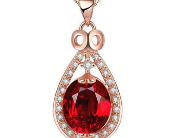 Trés beau pendentif cuivré strass blanc et cristal rouge, chaine cuivré.