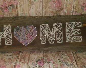 Home string art on old barnwood.