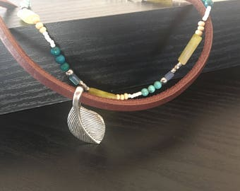 Leather choker with silver leaf pendant
