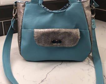 Teal and snake skin print handbag