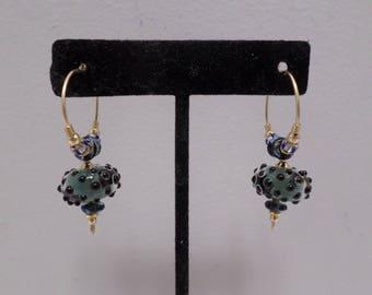 Gold Tone Metal Hoop Earrings with Blue Murano Glass Beads