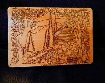 Wood Burned Wall Hanging of a Cabin in the Woods