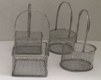 Set of four small metal baskets