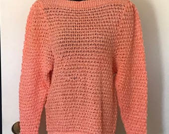 Hand-knitted sweater in orange