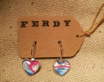 Handmade earrings containing an original abstract painting.