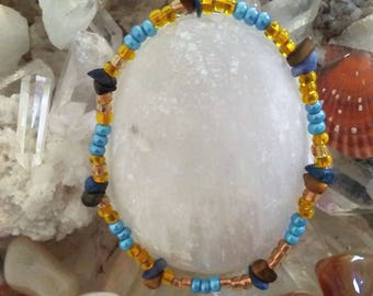 Blue, Yellow Beaded Bracelet Tiger Eye, Sodalite Chips, A Tiger Eye Crystal And Card With The Crystal's Meaning, Size 7 and 3/4 inches