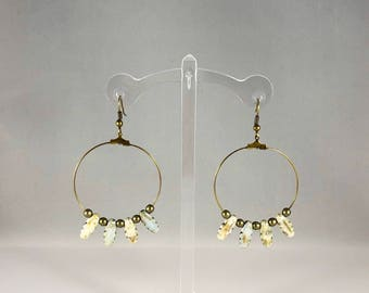 Hoop earrings with unique bead accent