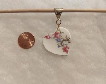 Heart shaped broken china pendant.