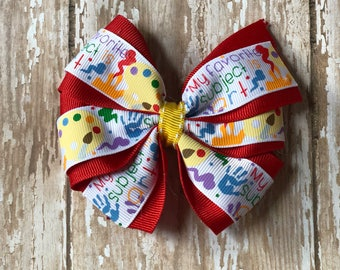 """Double stacked pinwheel bow """"art is my favorite subject"""""""