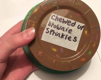 Chewed up brownie sprinkles