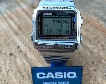 Casio DB-590 Mod1252 Data Bank Rare Vintage Multi Lingual Good condition new battery ILLUMINATOR WR Alarm stainless steel strap original