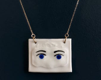 Dark blue, glazed porcelain, hand painted Medallion 'Eyes'.