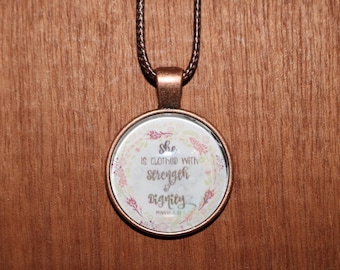 She is clothed in strength and dignity pendant necklace