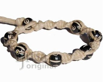 Natural twisted hemp bracelet with round black bone beads throughout