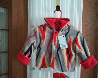 Fleece hooded jacket 6 to 12 month in red,ivory,navy, astec print. Snap front. Matching thumbless mittens. Items lined in same.