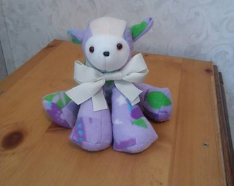 Lamb in fleece for babies nursery. Primary color lavender. Measures 10 long. Safety eyes n nose. Hypoallergenic stuffing.