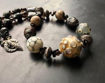 Lori Lochner handmade lampwork blown glass jewelry statement necklace earthy neutral mix artisan tribal beaded glass jasper and topaz.
