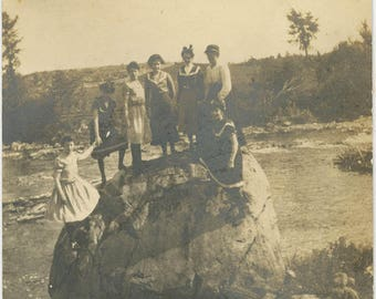 vintage photo 1910 Women Climb Up Giant Rock On Shores Of River