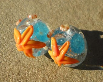 Handmade glass- lampwork bead pair- starfish beads with bubble surf in aqua blue, apricot orange, and ivory.
