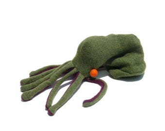 A Green and Purple Octopus with Orange Eyeballs