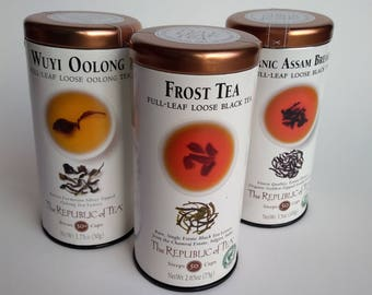 Three empty Republic of Tea Wuyi Oolong Frost tea and Organic Assam Breakfast for craft projects or reuse