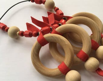 Wooden beads and red suede necklace by Mainichi