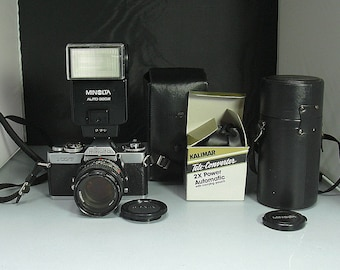 Vintage Minolta XD-7 35mm Film, Sigma Zoom, Kalimar Tele Converter and Minolta Auto 320X Flash plus Instruction Booklets