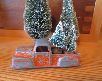 "Vintage Metal Tootsie Toy Truck Carrying 2 Sisal Bottle Brush Trees Loaded and Ready for Delivery / chippy orange paint / 3"" truck Decor"