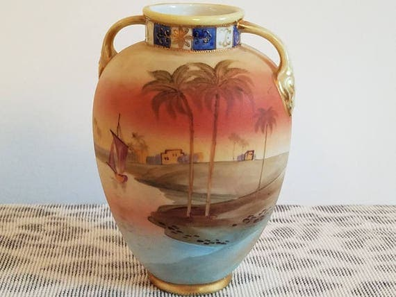 Antique Nippon Japan hand painted porcelain ceramic vase urn with eared handles Egyptian dessert oasis scene