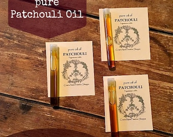 Pure Patchouli Essential Oil in glass Vial size with perfume applicator top spread peace