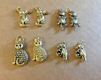 Eight cat charms
