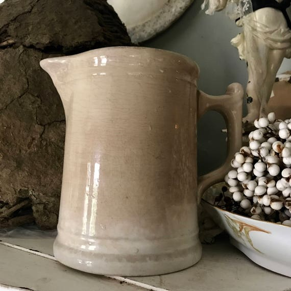 White Ironstone pitcher, with crackle and staining