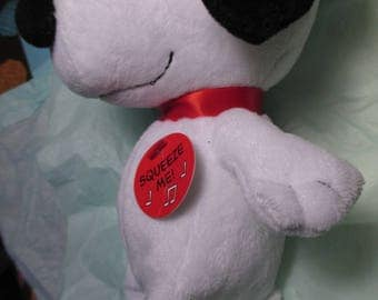 TY Beanie Baby Snoopy Peanuts Character Charlie Brown Dog PLAYS MUSIC united features collectible
