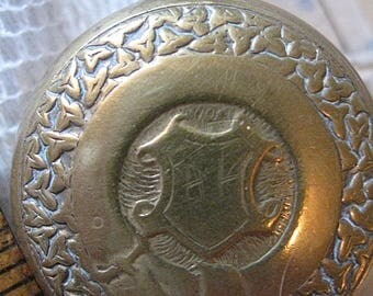 Antique Brass Coin Holder As Is Scratches on Face No Loop For Suspension Will Hold At Least A Nickel Maybe Two Read Full Details Please