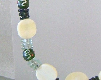 SALE Vintage Green Glass, African Trade Beads and Bone Necklace.  Unique Bone, African Trade Beads, and Carved Glass Necklace.