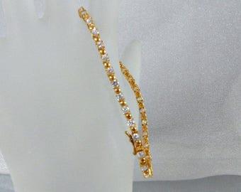 SALE Vintage Tennis Bracelet.  Gold Over Sterling Silver.  Cubic Zirconia.