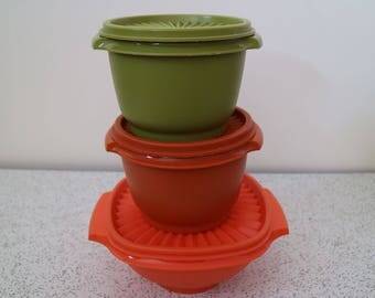 trio of 1970s vintage tupperware containers with fan lids