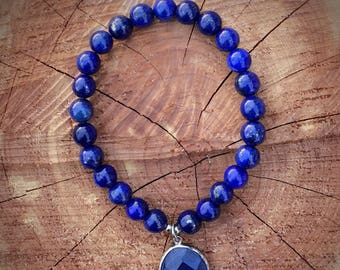 Blue lapis lazuli beaded bracelet with charm