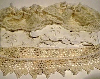 Lace garters, cut work scraps, lace pieces in creamy white