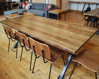 Reclaimed wood conference table with steel legs in choice of size, thickness and finish