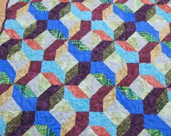 Batik lap quilt multicolors with raspberry back 61 x 48
