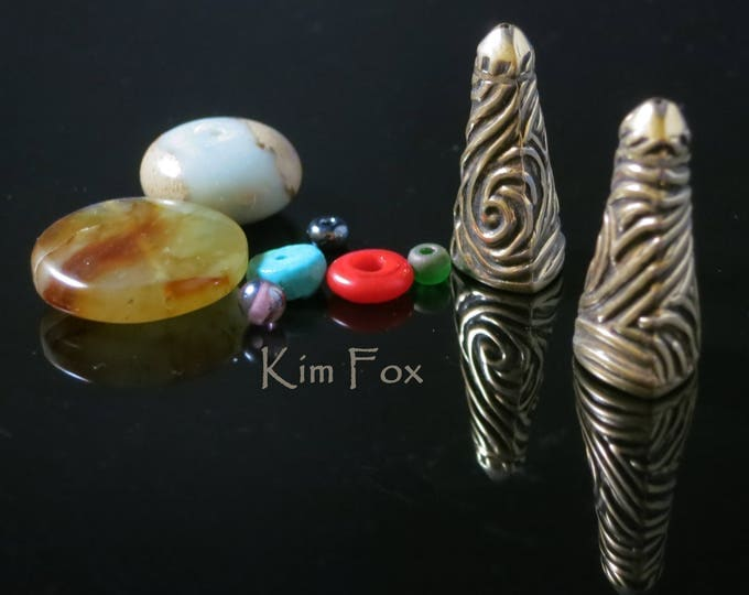 Featured listing image: Triangular Cones with Swirl Texture in Golden Bronze 24mm x 9 mm opening designed by Kim Fox