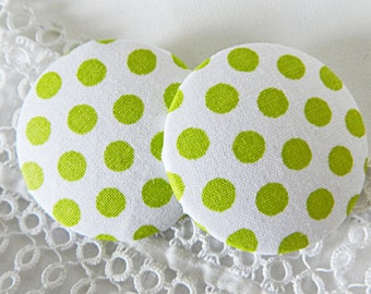 White fabric button with green polka dots, 40 mm in diameter