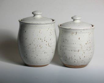 Couple of canisters glazed white