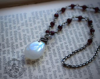 Moonstone and Garnet Necklace in Sterling Silver.  The Moonlit Tear Necklace.