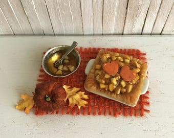 Miniature Apple Cobbler In Square Baking Dish With Pumpkins On Top and A Bowl Of Pie Filling