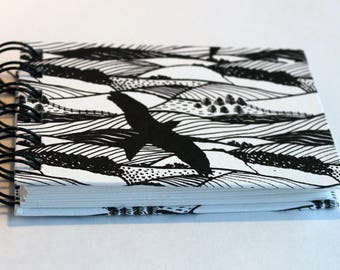 Wire ringbound artists pocket notebook ,sketchbook or journal in Black and White with gulls and red kite birds, blank, hardback, sketch draw