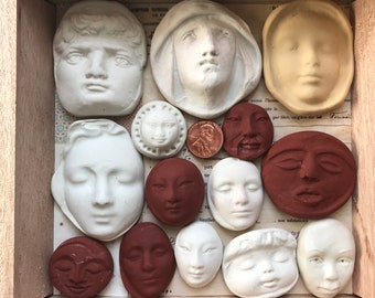 Assortment of Polymer Clay Molded Faces in a Designer Cigar Box