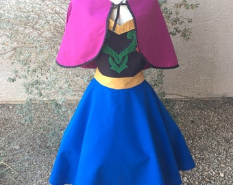 Anna apron dress with capelet